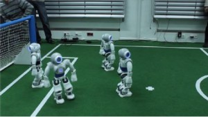 4 Nao robots on the football pitch ready to play football