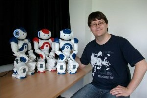 Markus Häring with Nori, Nali and Nyr Nao humanoid robots
