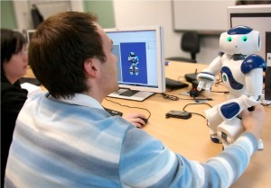 Students working with Nao and Choregraphe in a practical course