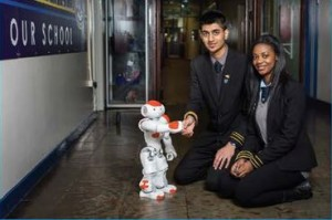 Nao met by the head boy and girl of KHS